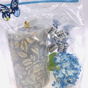 Presentpåse: Stort blockljus, blomma, mintkolor